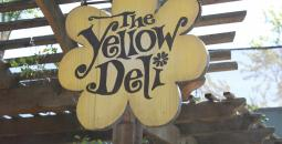 Yellow deli sign